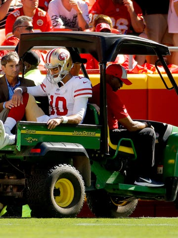 San Francisco 49ers quarterback Jimmy Garoppolo (10) is carted off the field after being injured during the second half of an NFL football game against the Kansas City Chiefs, Sunday, Sept. 23, 2018, in Kansas City, Mo. (AP Photo/Charlie Riedel)
