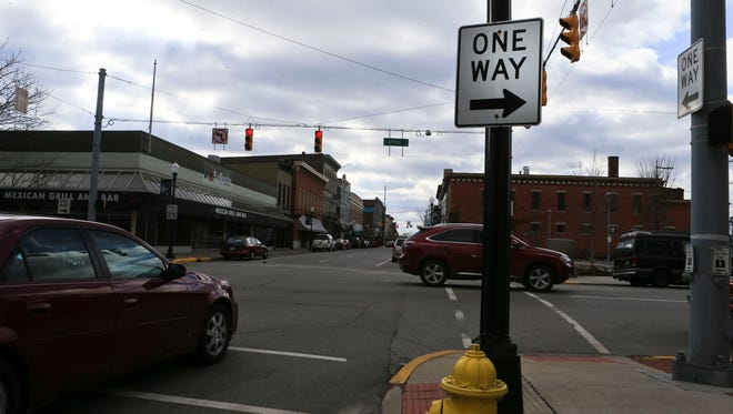 """Most downtown streets in New Albany are one-way but city officials are contemplating changing that. """"If New Albany courageously changes its streets from one-way to two-way, it will pay for itself with higher home values and better downtown business,"""" said John Gilderbloom, director of the University of Louisville's department of urban and public affairs. He was addressing the Indiana city's recent push toward changing its downtown street grid."""