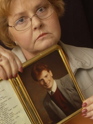 A 2004 photo of Mary Doemel with a photograph of her son, Tim Jr.