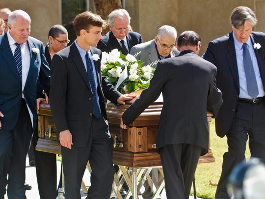 In this Sept. 16, 2017, file photo, pallbearers walk the casket of Sen. Pete Domenici to a hearse after the funeral Mass at Our Lady of Fatima Church in Albuquerque, N.M. New Mexico's longest serving senator died of complications from abdominal surgery.