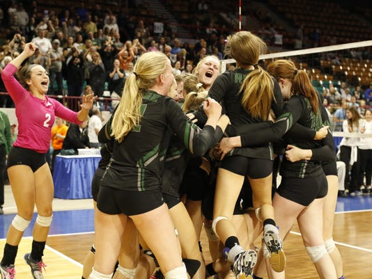 Fossil Ridge celebrates a fifth set victory to clinch the 5A State Championship against Mountain Vista, Nov. 12 at the Denver Coliseum. Fossil Ridge defeated Mountain Vista 3-2.Photo by Philip B. Poston
