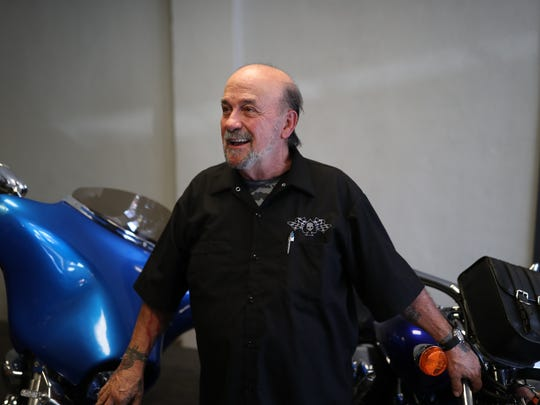 Joe West, who has filed to run for the office of Mayor, at Orion Motorsports Tuesday where he barters his time as a salesman in trade for mechanical work on his vehicles. West receives disability pay from his Vietnam veteran status, serving in both the Army and Navy.