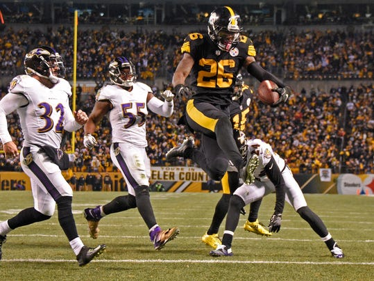 FILE - In this Dec. 25, 2016, file photo, Pittsburgh Steelers running back Le'Veon Bell (26) leaps into the end zone ahead of Baltimore Ravens strong safety Eric Weddle (32) for a touchdown during the second half of an NFL football game in Pittsburgh. The Steelers have put the franchise tag on All-Pro running back Le'Veon Bell for a second straight spring, putting his long-term status with the club up in the air. (AP Photo/Don Wright, File)