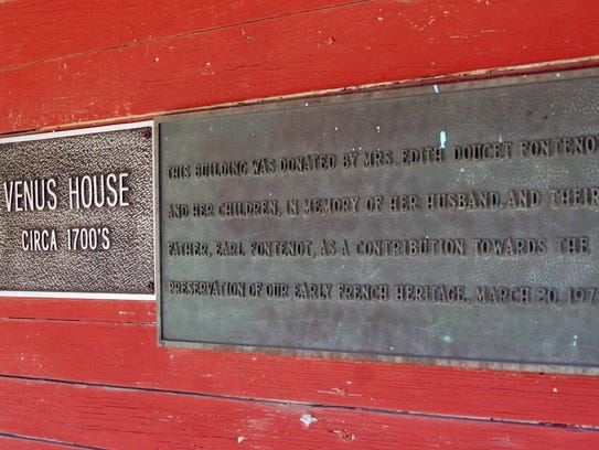 A plaque on the Venus House.