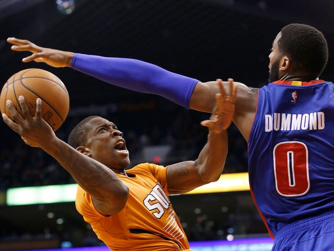 Phoenix Suns' Eric Bledsoe, left, gets fouled as he