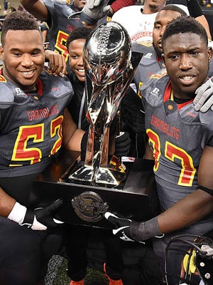 Grambling players hoist up the Bayou Classic trophy in 2015 after beating Southern in New Orleans.