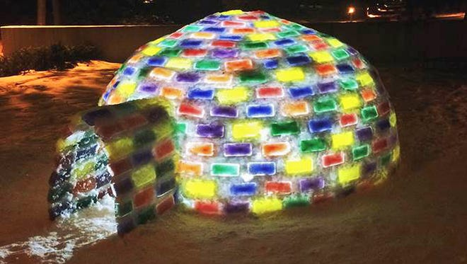 St. John's University freshman Mitch Fritz's igloo glows at night on the campus. Fritz has attempted to build other igloos but this is his first successful one.
