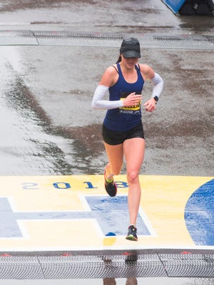 Sarah Sellers of the United States crosses the finish line in second place in the Boston Marathon elite women's race April 16  in Boston.