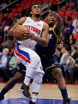 Pistons guard Ish Smith (14) is guarded by Jazz guard Joe Johnson (6) while going to the basket during the second half of the Pistons' 98-95 overtime loss on Wednesday, Jan. 24, 2018, at Little Caesars Arena.