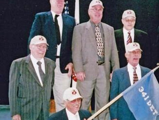 Retired Lt. Col. Bob Pedigo, left, and members of his