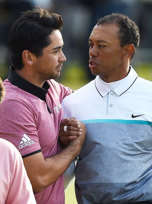 Tiger Woods and Jason Day during the 2015 British Open. The two will tee off together at Torrey Pines on Thursday.