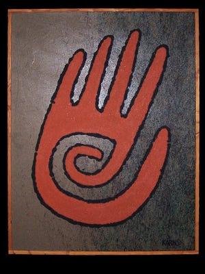 Michael Karns prefers sand and sawdust to create his artwork.