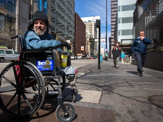 """Jeff Branham, 52, has been living on the streets of downtown Cincinnati of and on since 1996. While living in Queensgate at a homeless camp in 2007, he lost both legs while attempting to climb over a train and falling. He said he's homeless because of """"A whole lot of bad decisions. A lot of bad decisions."""" Most nights, he's able to find housing with friends. Branham grew up in the back woods of Kentucky. Chico Lockhart, a social worker employed by DCI (Downtown Cincinnati Inc) to help the homeless, has been trying to get Branham off the street for years."""