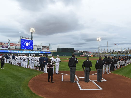 The National Anthem is sung on the Reno Aces' opening