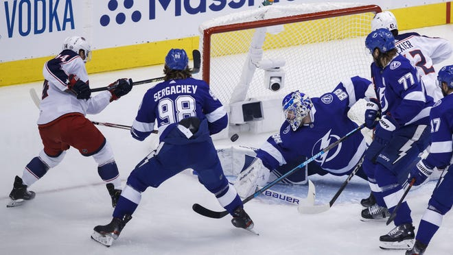 Tampa Bay Lightning goaltender Andrei Vasilevskiy (88) makes a stop on Columbus Blue Jackets center Gustav Nyquist (14) during the second period of an NHL hockey Eastern Conference Stanley Cup first round playoff game in Toronto, Wednesday, Aug. 19, 2020.