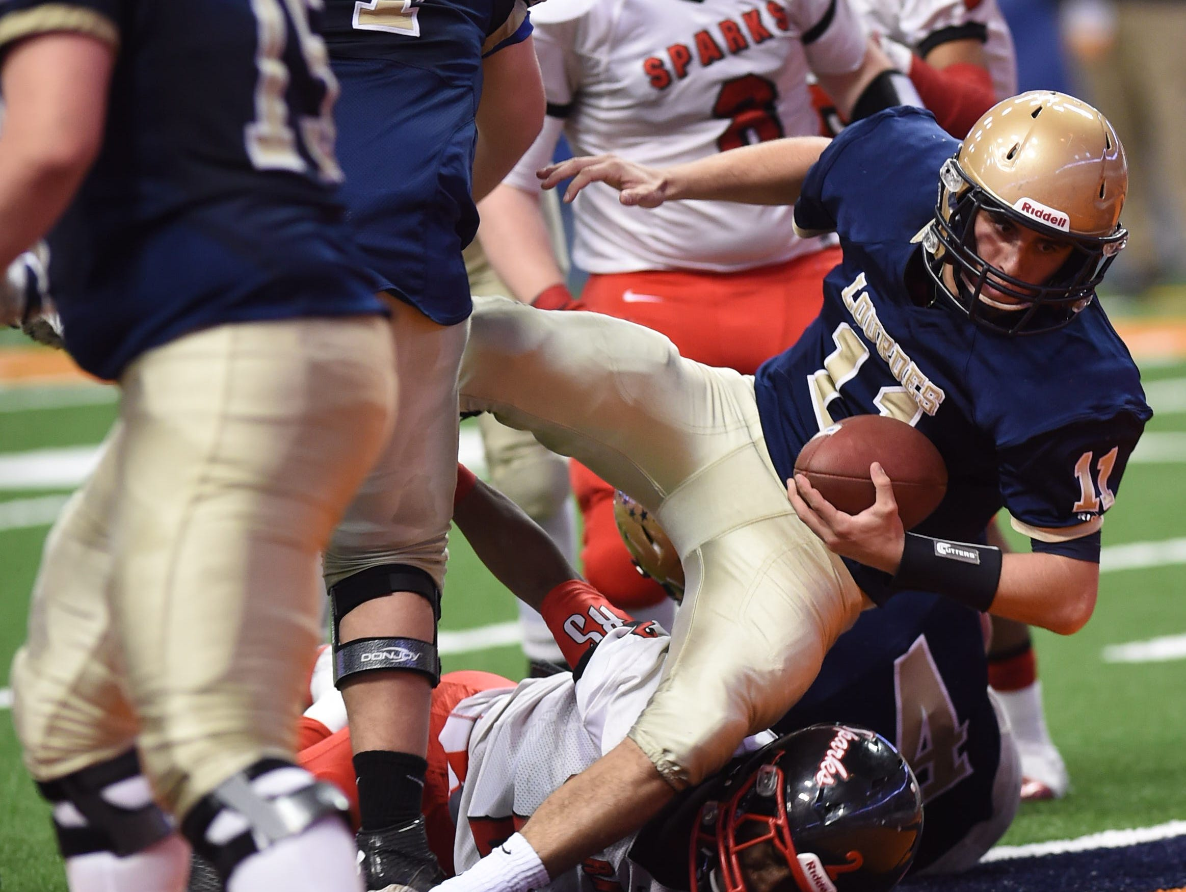 Lourdes' Luke Timm carries the ball into the end zone during the New York State Championship final versus South Park in Syracuse on Friday.