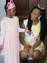 Mariah Robinson, 7 of New Castle talks with Miss Capital