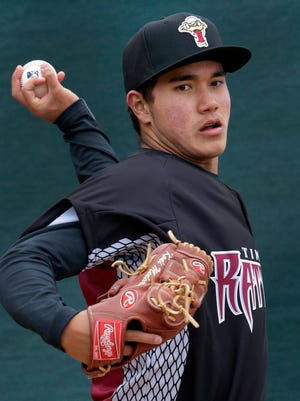 Wisconsin Timber Rattlers pitcher Kodi Medeiros throws in the bullpen during FanFest on Tuesday at Neuroscience Group Field at Fox Cities Stadium in Grand Chute.