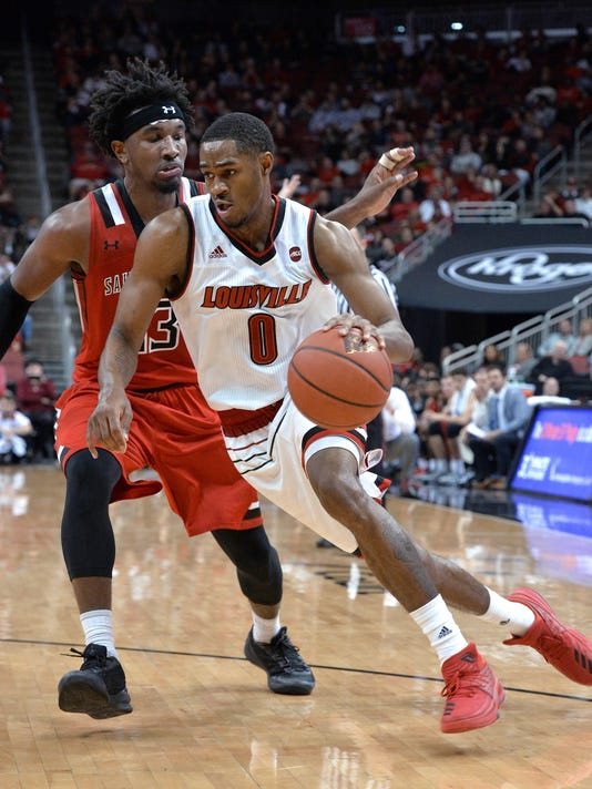 Louisville forward V.J. King (0) drives past Saint Francis guard Keith Braxton (13) during the second half of an NCAA college basketball game, Friday, Nov. 24, 2017, in Louisville, Ky. Louisville won 84-72. (AP Photo/Timothy D. Easley)