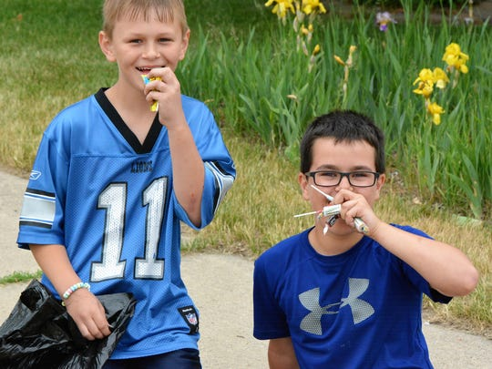 Luke Holgrem and Owen Trepanier didn't wait to start enjoying their candy from the Copperfest Parade in Oconto on June 9.