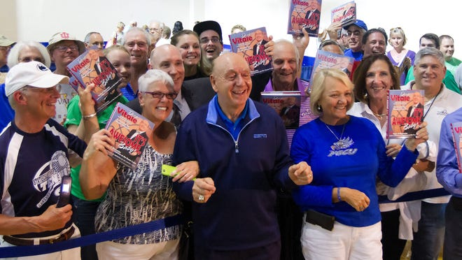 Dick Vitale relaxes with fans during his book-signing event Wednesday at Alico Arena. More than 150 people attended the event before FGCU's game against North Florida, which Vitale attended.