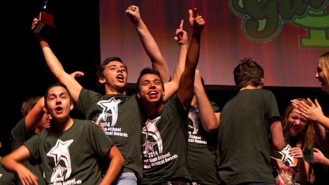 Actors Edwin Gamboa, left, Axel Froese and Steven Angulo celebrate Island Coast High School's win for Outstanding Overall Production at the 2014 High School Musical Awards on Monday. To see more photos visit news-press.com.