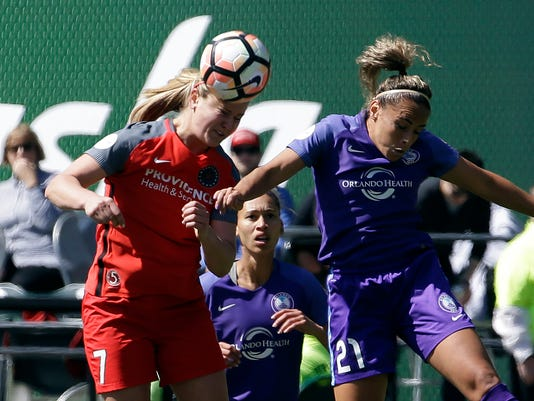 Portland Thorns midfielder Lindsey Horan, left, heads the ball against Orlando Pride defender Monica Hickmann Alves during the first half of an NWSL soccer match in Portland, Ore., Saturday, April 15, 2017. (AP Photo/Don Ryan)