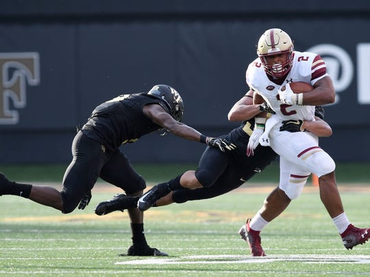 AJ Dillon breaks a tackle during a game against Wake Forest.