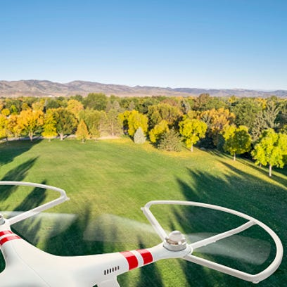 Drone flying over park