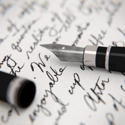 Handwritten letter and fountain pen