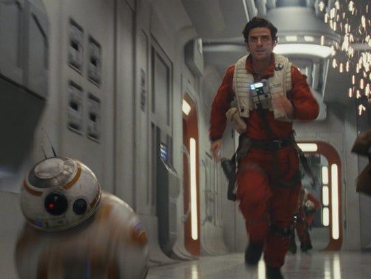 BB-8 and Poe Dameron (Oscar Isaac) race into battle