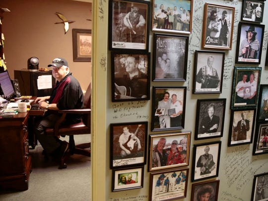 KBON 101.1 FM owner Paul Marx sits in his office at the Eunice-based radio station, the walls of which are adorned with photos of various musicians.
