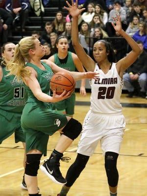 Ava McCann of Binghamton Seton Catholic Central drives to the hoop as Elmira's Zaria DeMember-Shazer defends Dec. 30 during the girls championship game at the Josh Palmer Fund Elmira Holiday Inn Classic at Elmira High School.
