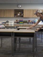 Courtney Wilson arranges desks in her third-grade classroom, July 30, 2018, at Hopi Elementary School, 5110 E Lafayette Blvd., Phoenix.