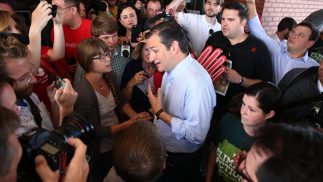 Republican presidential candidate Ted Cruz speaks to supporters and media on Friday, Aug. 21, 2015, at the Iowa State Fair in Des Moines, Iowa.