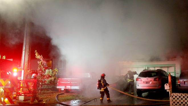Firefighters work the scene of a house fire early Saturday in Port Orchard.