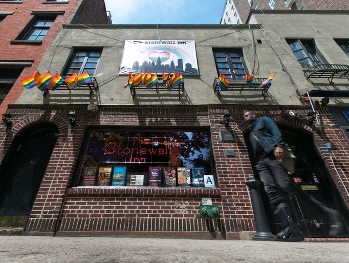A man passes The Stonewall Inn in New York's Greenwich