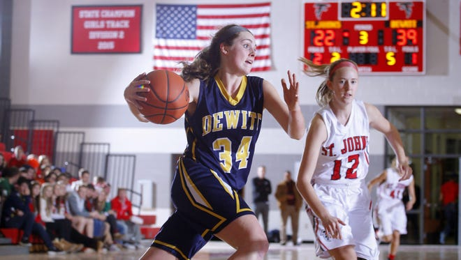 DeWitt's Grace George, left, drives against St. Johns' Nicole Miller earlier this season. George is the leading scorer for the Class A No. 8-ranked Panthers.
