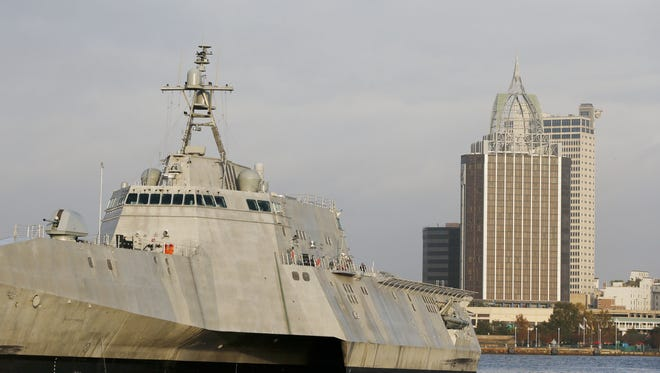 """Mobile, Alabama, is seen behind the docked USS Gabrielle Giffords, named in honor of former U.S. Rep. Gabrielle Giffords of Arizona. In this Wednesday, Nov. 30, 2016, photo, the city scape of Mobile, Ala., is seen behind the docked USS Gabrielle Giffords, a Naval littoral combat ship built at the Austal USA shipyards on the Mobile River in Mobile, Ala. The ship is named in honor of former U.S. Rep. Gabrielle """"Gabby"""" Giffords of Arizona. Giffords, the former Arizona congresswoman who was shot in the head during an assassination attempt in 2011, helped christen the ship in 2015. It's part of a hotly debated program that congressional critics slam as flawed and too expensive but that Navy leaders defend as a critical new step in naval warfighting. (AP Photo/Brynn Anderson)"""