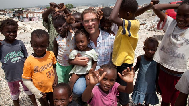 Magnus MacFarlane-Barrow, shown here in Haiti, is the founder of Mary's Meals.