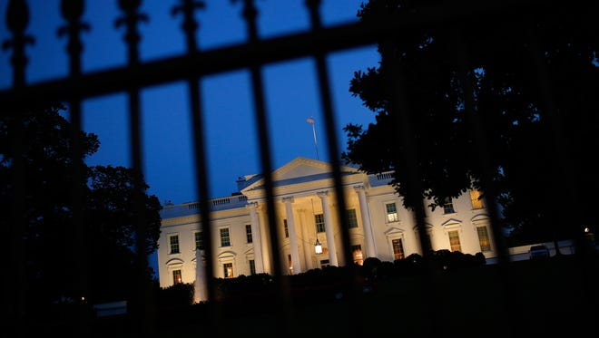 The White House is lit at dusk shortly before President Obama is scheduled to address the nation on Sept. 10, 2014.