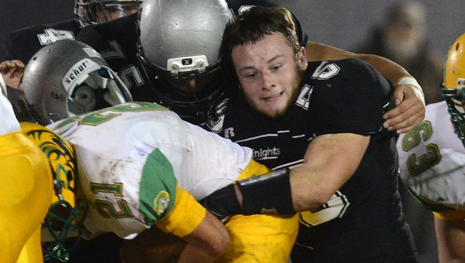 Robbinsville senior Creed Lovin (55) made a tackle without his helmet on in last Friday's 1-A Western Regional championship win over visiting Alleghany.