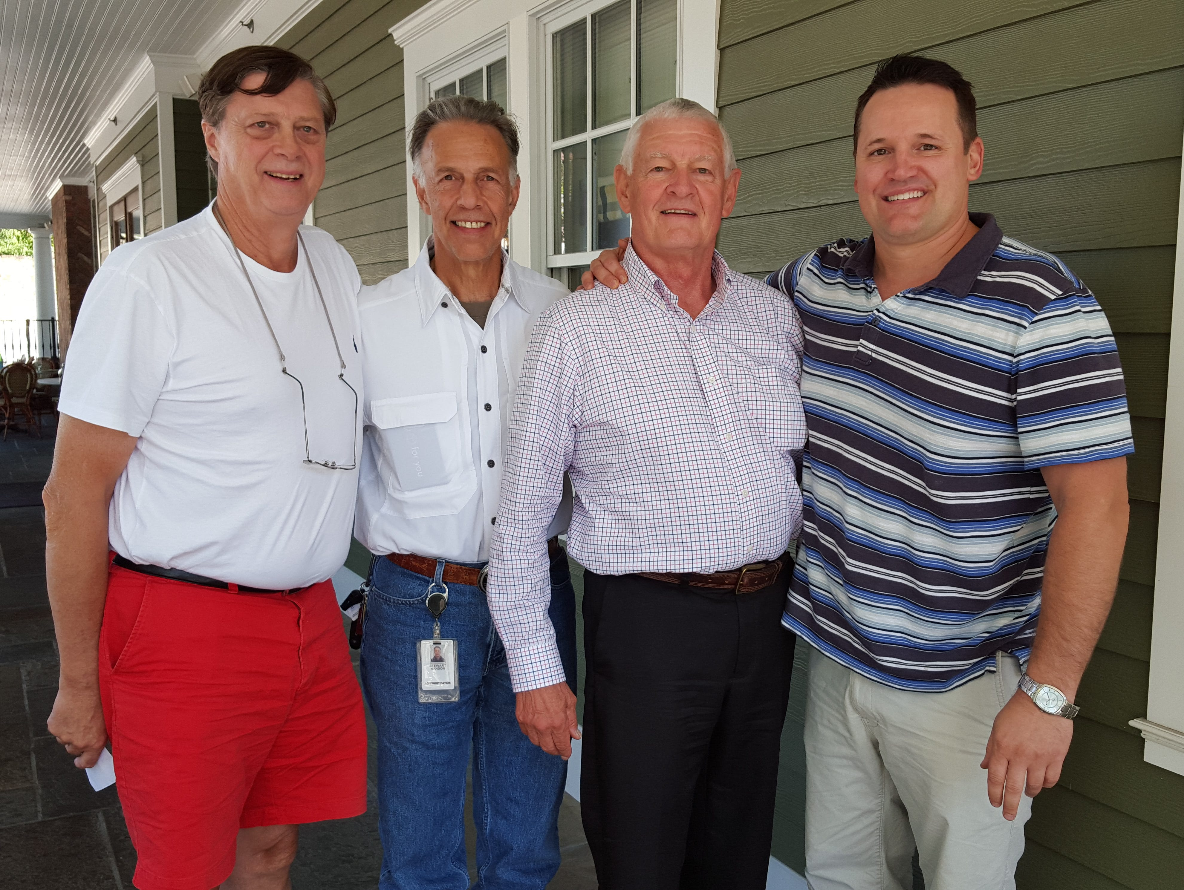 Captains of the Rye/Harrison Tradition Committee meet with the schools' athletic directors. Pictured from left to right): Rye's Steve Feeney, Harrison athletic director Stu Hanson, Rye athletic director Rod Mergardt and Harrison's John Stubenvoll.