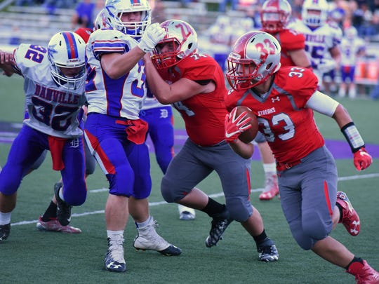 SJCC's Ross Snyder carries the football Saturday against Danville as Jacob Darr leads the way.
