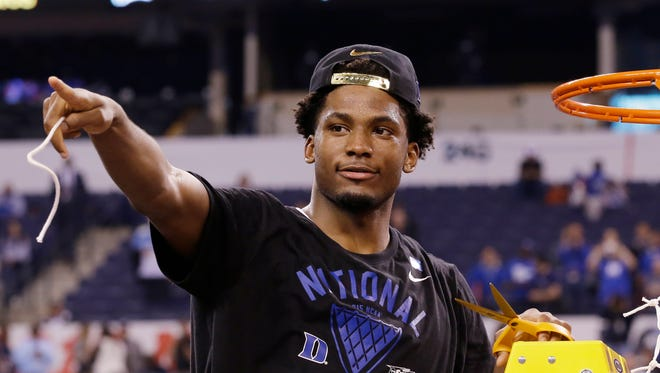 Duke's Justise Winslow cuts down the net after his team's 68-63 victory over Wisconsin in the national championship game on April 6 in Indianapolis.