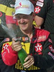Davey Allison celebrates in victory lane at Talladega