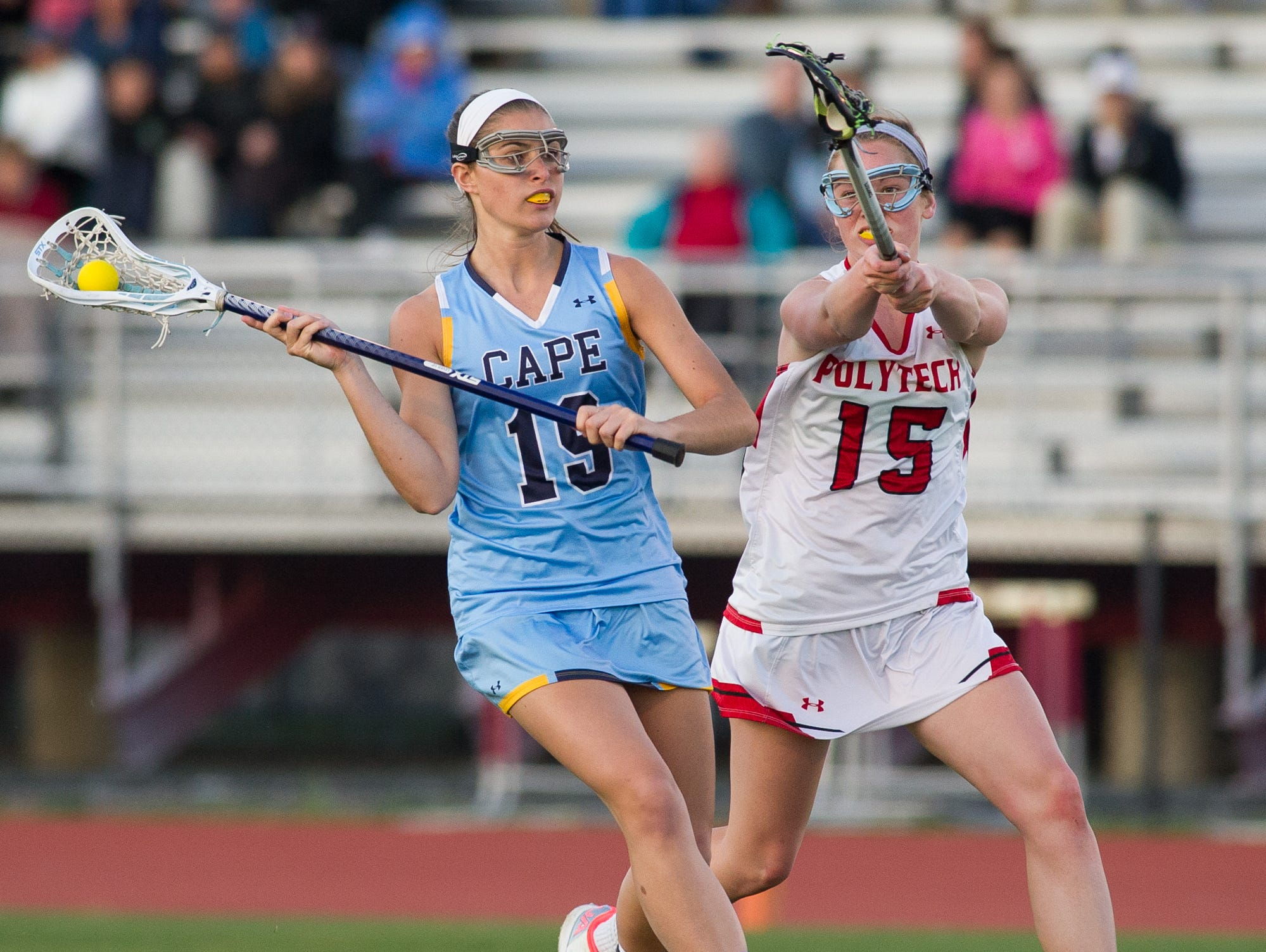 Polytech's Grace Stang (15), right tries to stop a shot from Cape Henlopen's Alison Palmer (19).