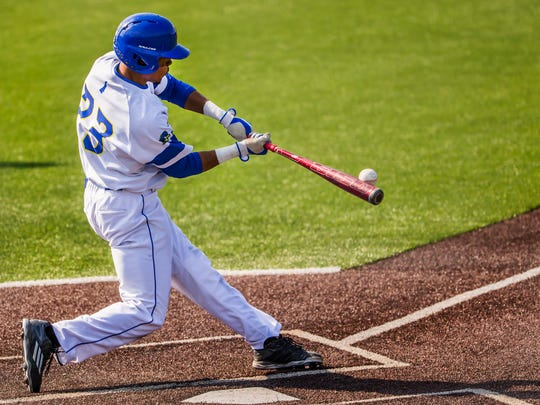 Delaware's Jordan Glover hits a home run to left field in Delaware's 12-2 loss to UNCW at Hannah Stadium at the University of Delaware on Thursday afternoon.