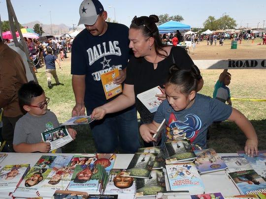 Jorge and Cynthia Moreno help their kids, Nathan and