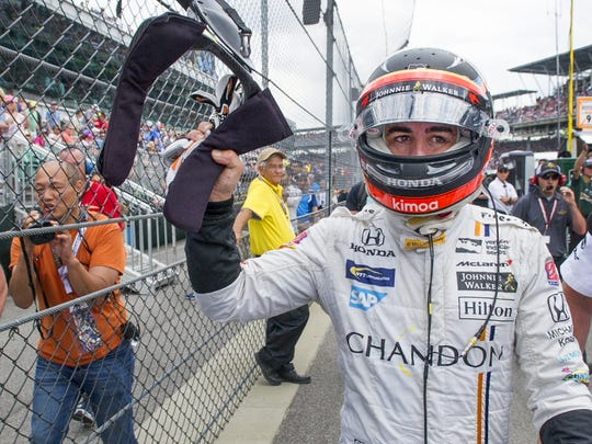 McLaren-Honda-Andretti IndyCar driver Fernando Alonso (29) walks the pit lane after an engine issue knocked him out of the 101st Indianapolis 500 Sunday afternoon.